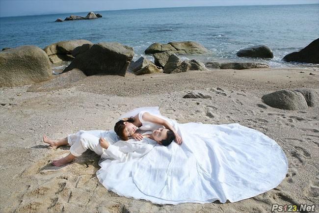 ps打造经典暗蓝色沙滩婚片