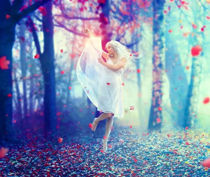 PS合成在唯美秋色树林中舞动的白衣美女